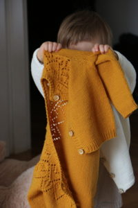 Lucie in home made knitted clothes
